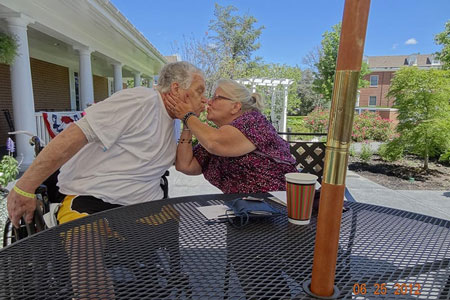 Veteran couple kissing at a fisher house